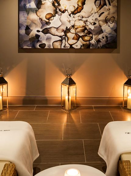 Gentle candle lights by spa beds for a perfect sense of relaxation with a treatment