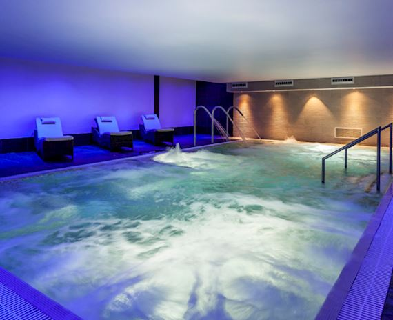 Luxurious Spa Pool with glamorous beds and chairs surrounding for ultimate relaxation